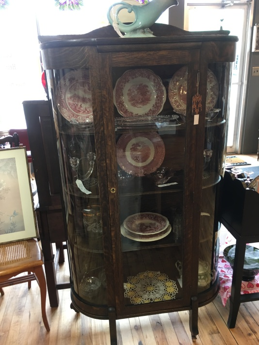 Curved China cabinet with original wavy glass. Three movable shelves and key.