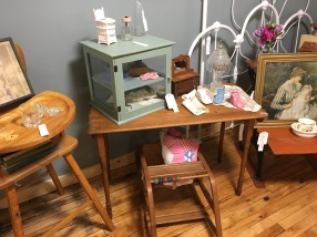 This primitive sewing table has collapsable legs.