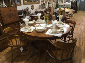 Timeless round tiger oak pedestal table set with beautiful Homer Laughlin china and vintage linens.