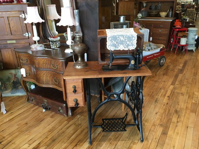 This treadle sewing machine is so sweet! The wrought iron is stunning.