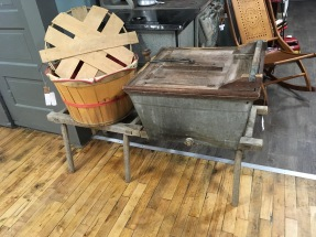 1800's washing machine and stand. Wouldn't this be an awesome decor piece on your porch filled with colorful summer flowers?