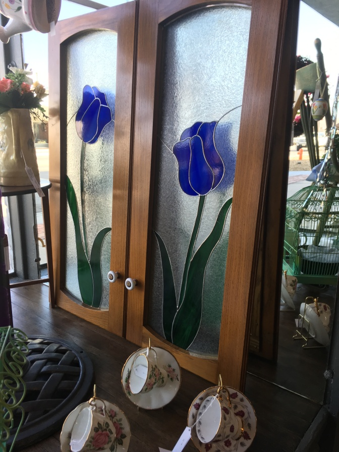 If you love stained glass, these cabinet doors are stunning. Beautifully crafted with blue tulips. Gorgeous walnut finish with porcelain knobs. Sold as a pair.