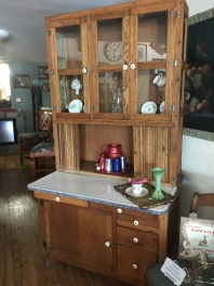 Beautiful Hoosier Cabinet with porcelain knobs and enamel top