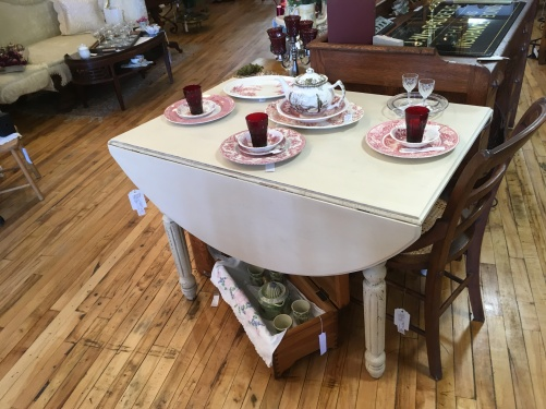 Sweet painted drop leaf table. Perfect for your porch or patio.