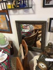 Antique framed mirror.