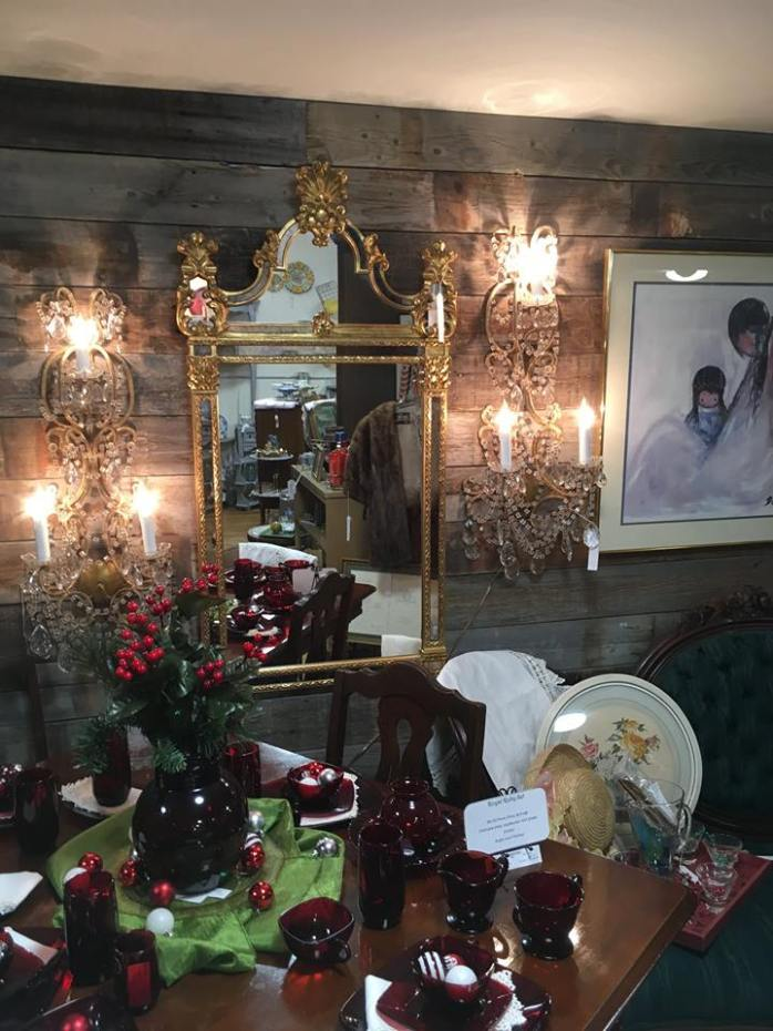 Beautiful mirror with crystal sconces.
