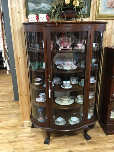Mahogany curved china cabinet with original glass.