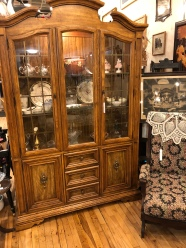 This china cabinet has unique brass inserts and is lighted.