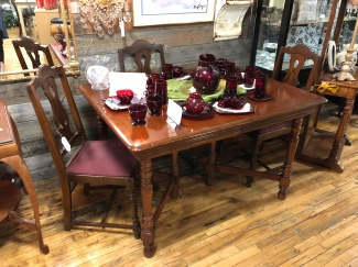 Vintage table with 6 chairs including captain's chair.