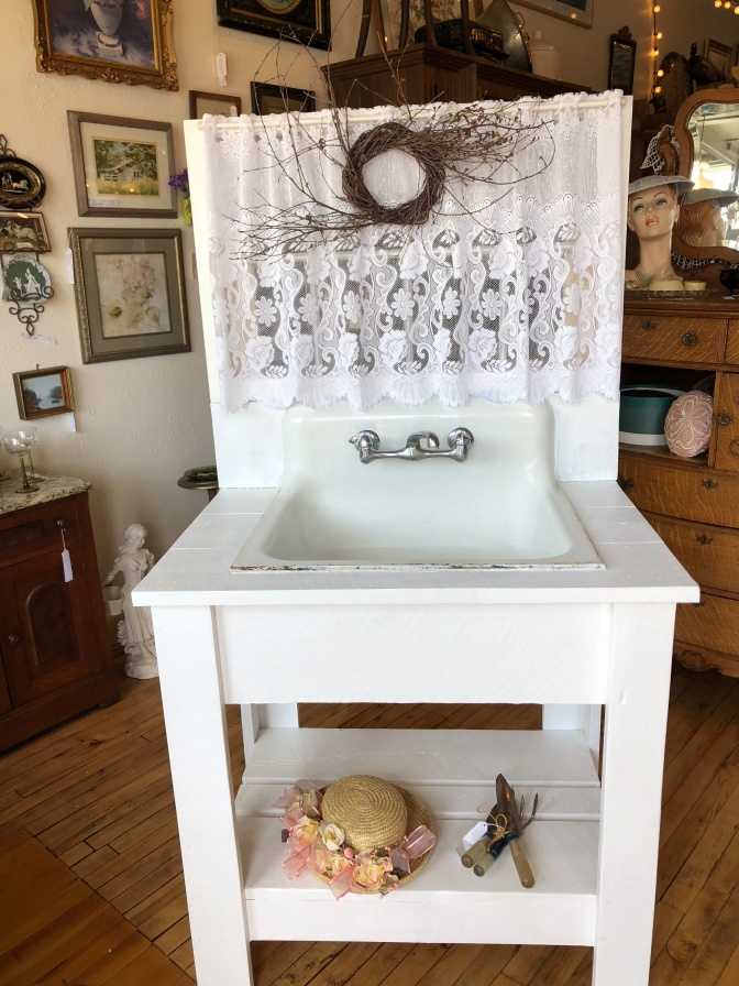 Unique Potting station made with vintage sink and window.