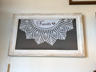 Beautifully re-imagined doily in frame.
