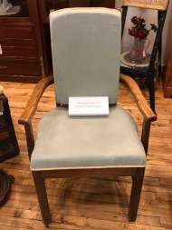 Four upholstered oak dining chairs.