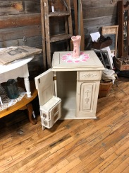 Chalk painted antique sewing cabinet