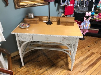 Cute as can be! Wicker/maple top desk or dressing table.