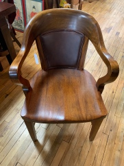Leather-backed Barrel Chair.