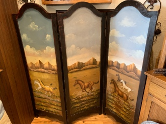 This unique hand-painted room divider is for the horse lover!
