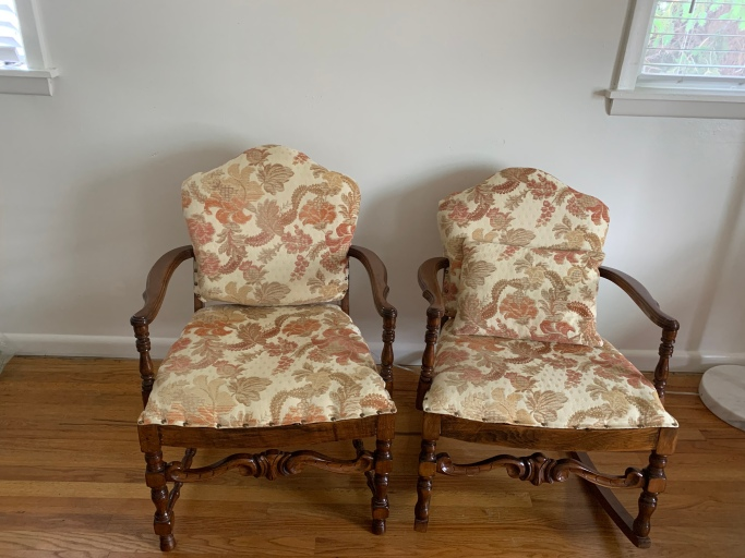 Matching upholstered chairs, one is a rocker.