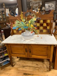 Breakfront with marble top and vintage porcelain tile.